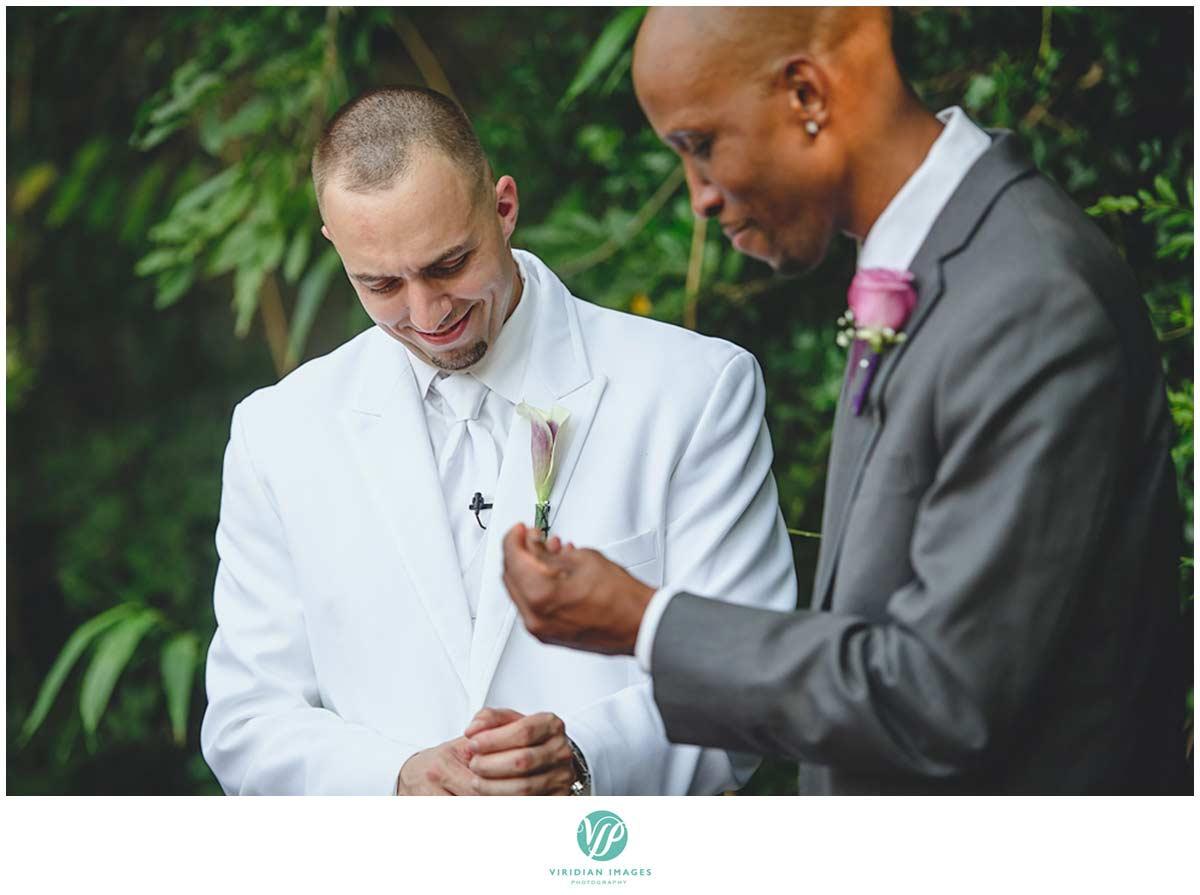 Atlanta-wedding-photographers-groom-white-tux-nerves-interracial-photo-5