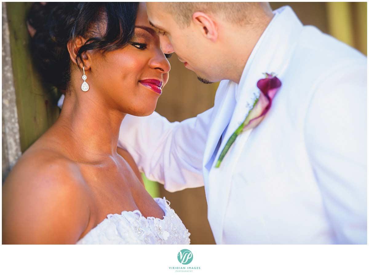 callanwolde-Atalanta-wedding-photographers-bridal-portrait-kiss-anticipation-interracial-photo-19