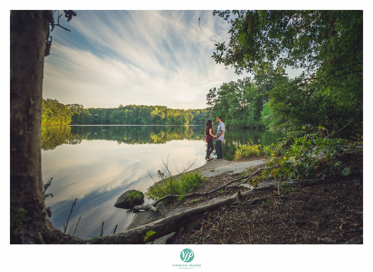 couple together near lake at stone mountain park