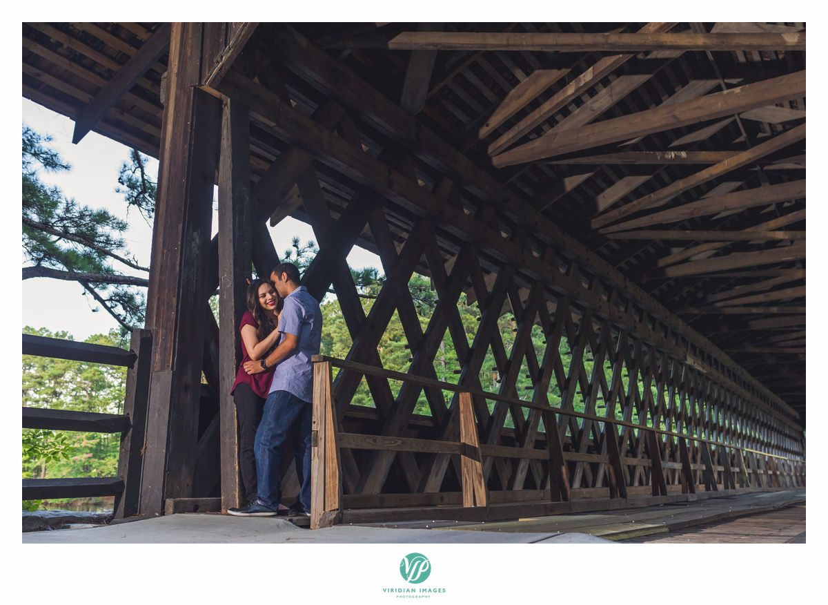 couple under covered bridge in stone mountain park