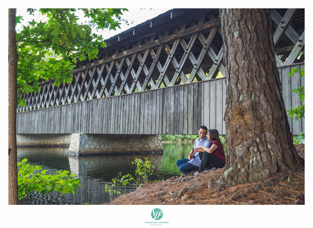 couple beside covered bridge in stone mountain park