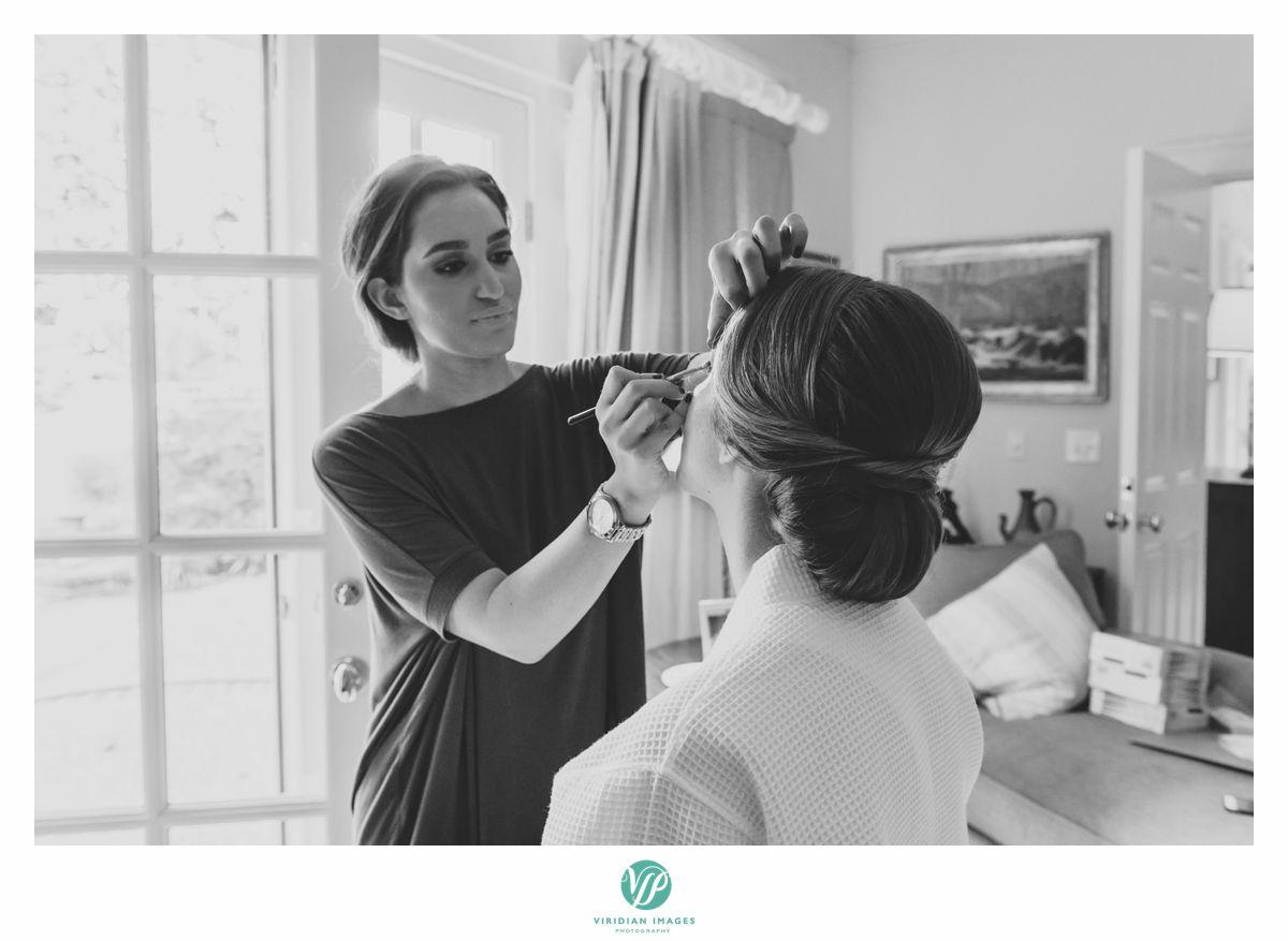 Makeup Artist applying bridal makeup