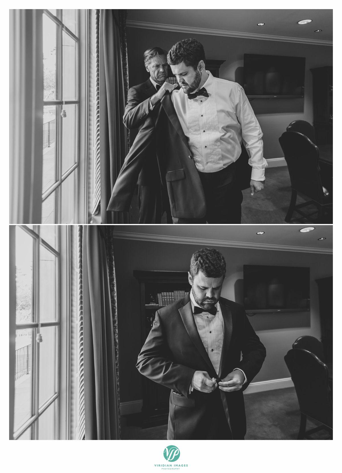 Groom putting on tuxedo