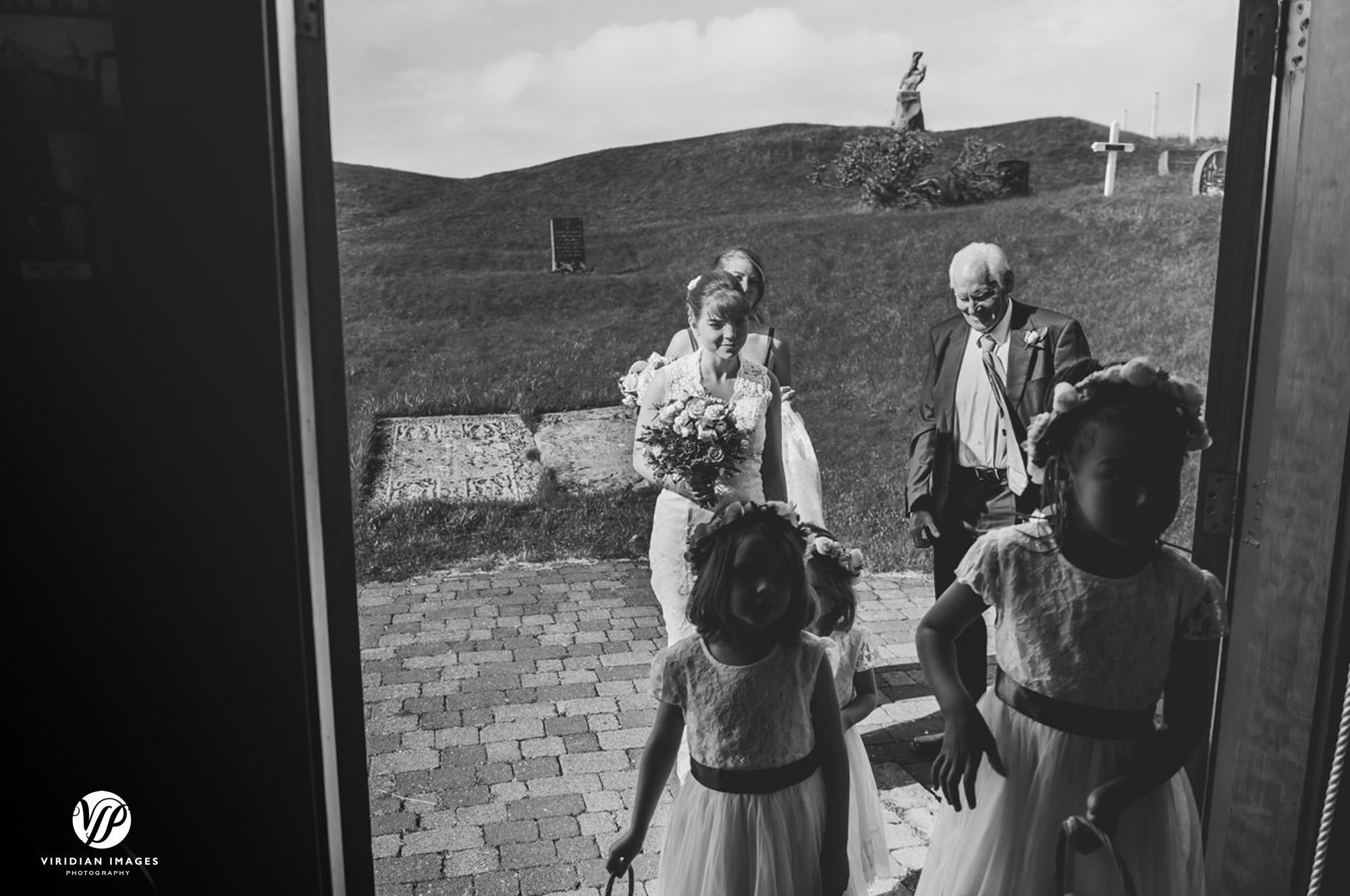 Bride with father and girls arriving at Oddakirkja Church in Iceland