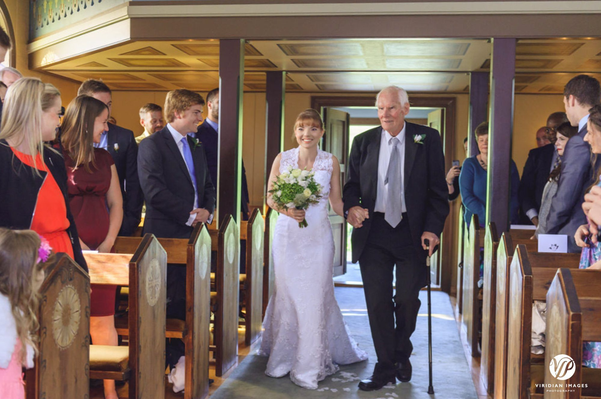 Bride wedding processional in Oddakirkja church Iceland