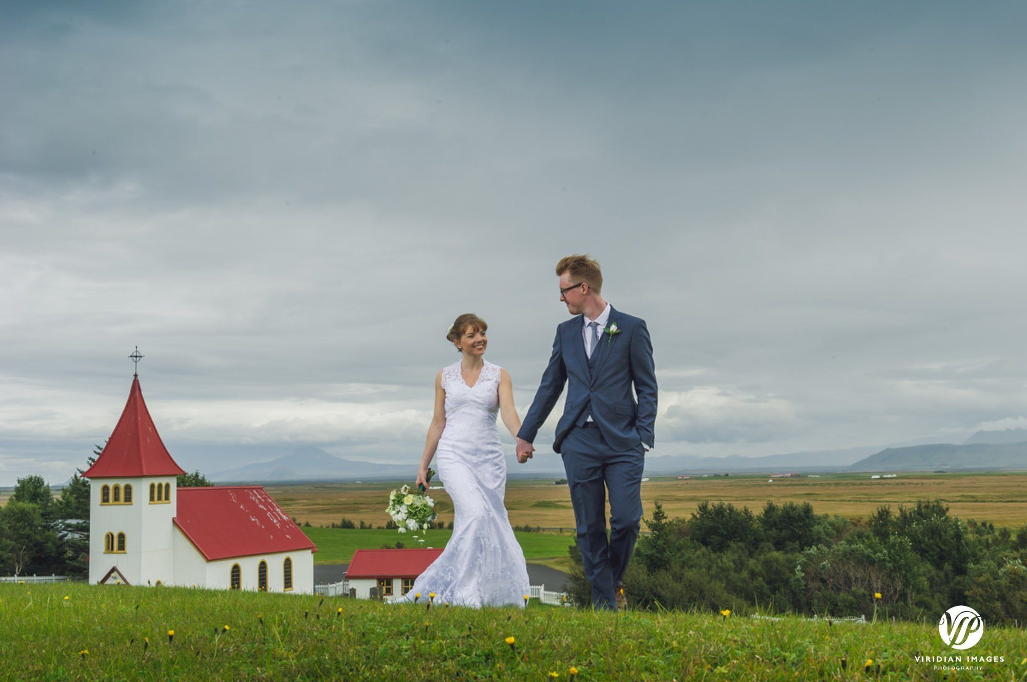 Bride and groom portraits front of Oddikirkja church in Hella Iceland