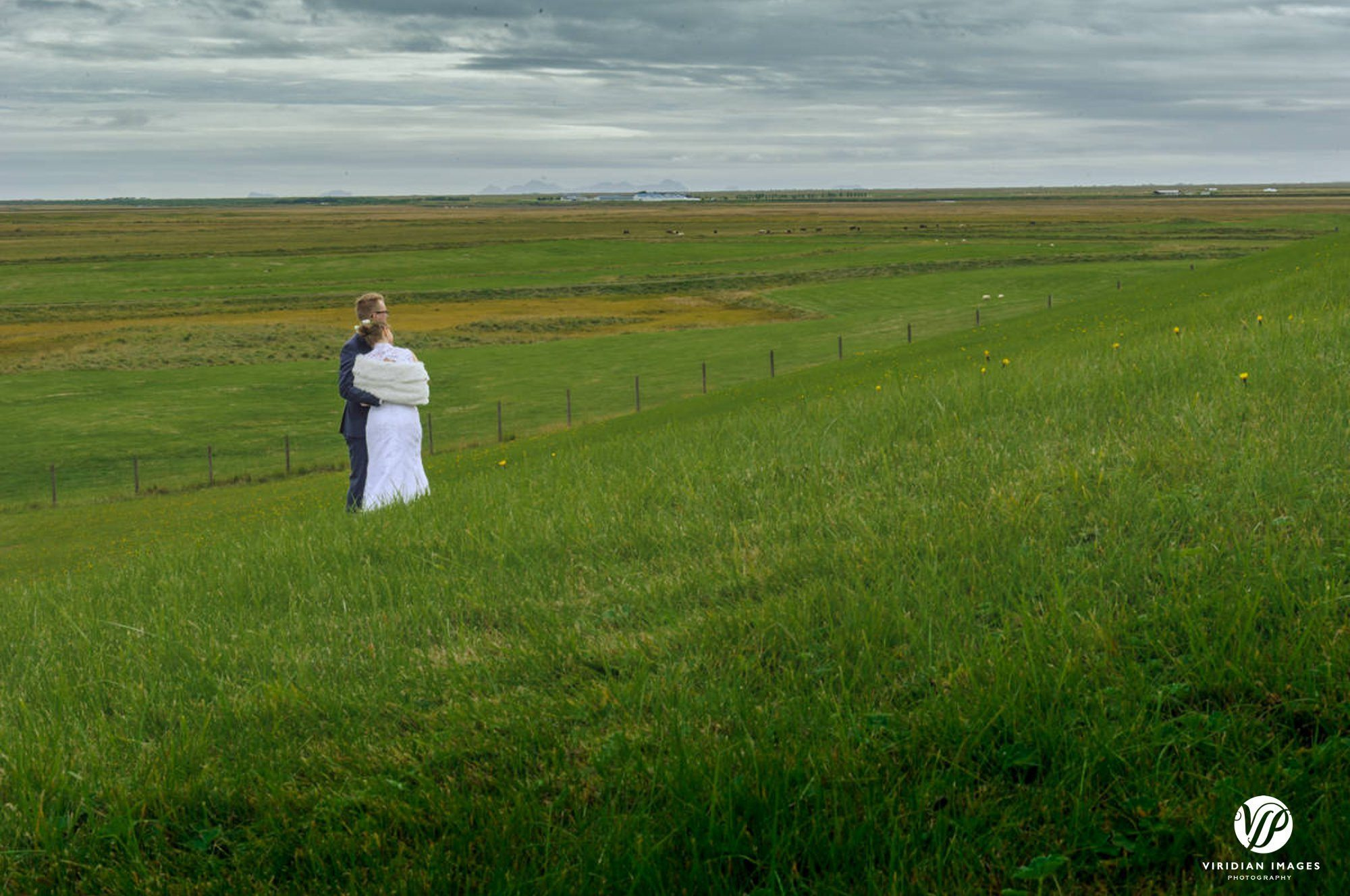 Bride and groom private moment enjoying scenery around Hella Iceland