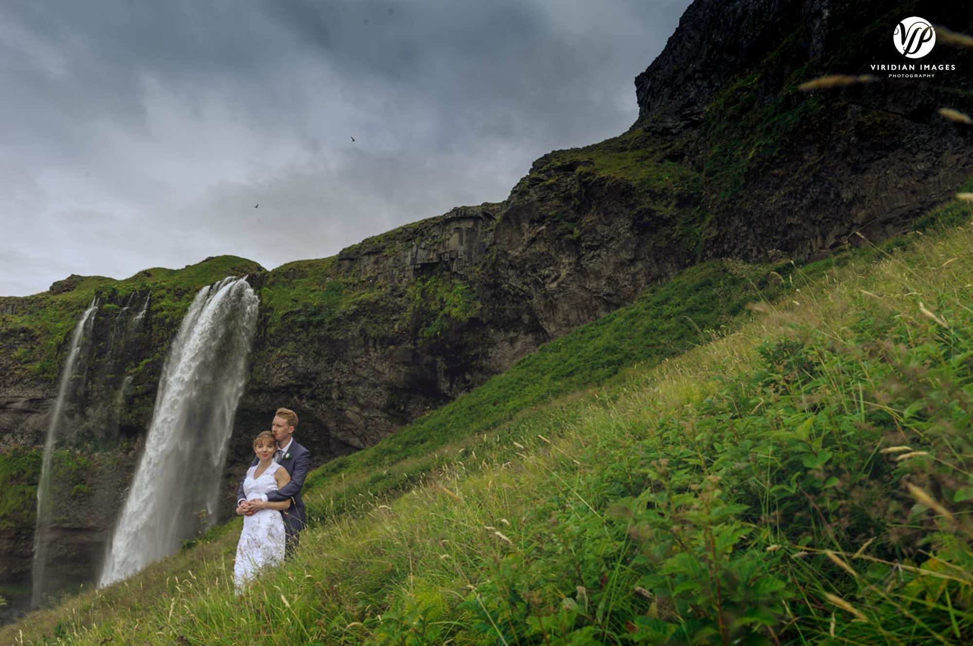 romantic portrait at Seljalandsfoss waterfall iceland