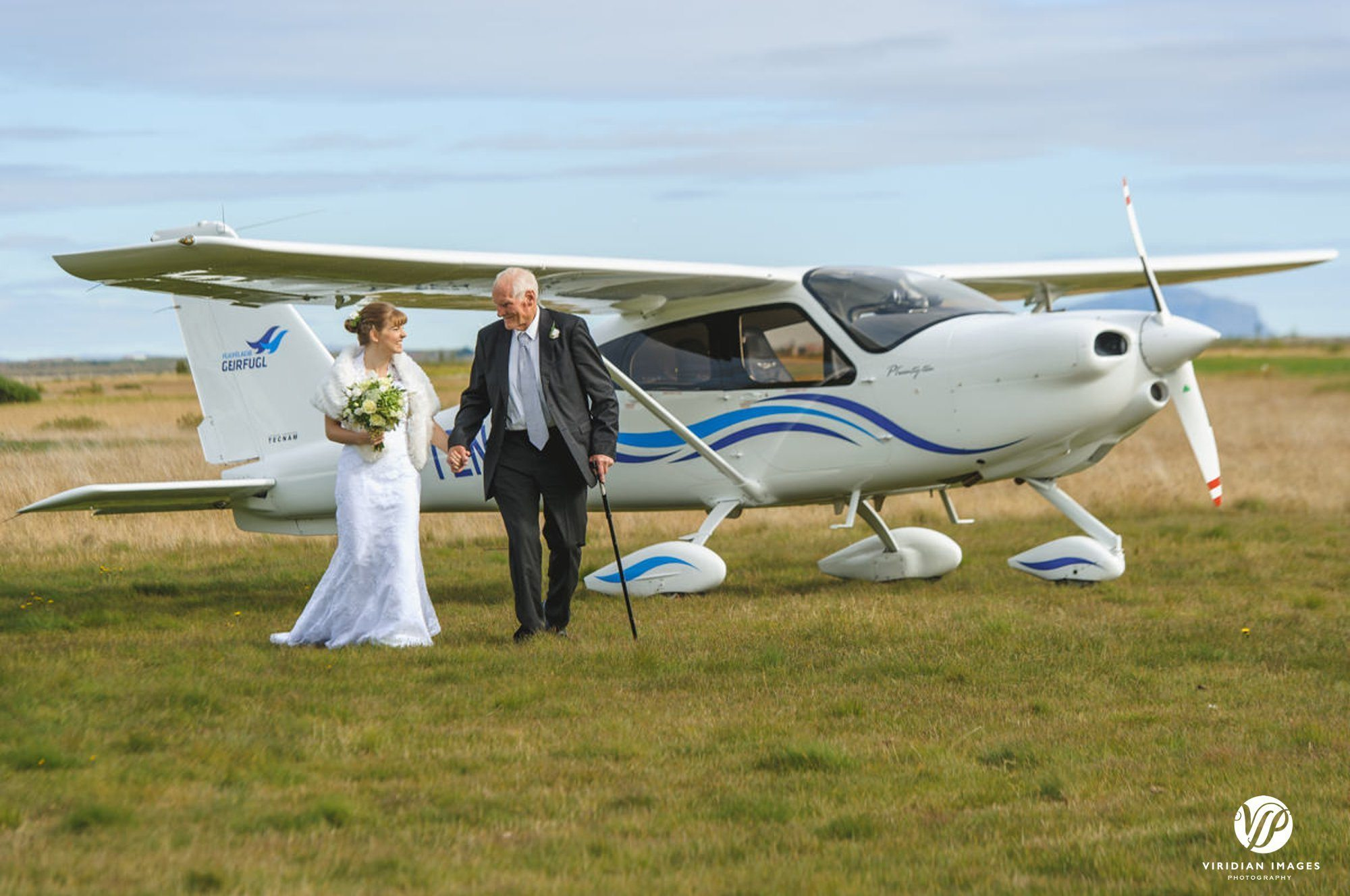 Bride and father leaving Tecnam plane in Hella Iceland
