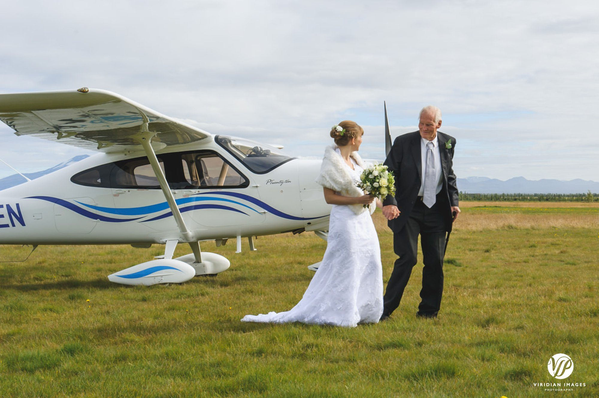 Bride and father leaving plane in Hella Icdland