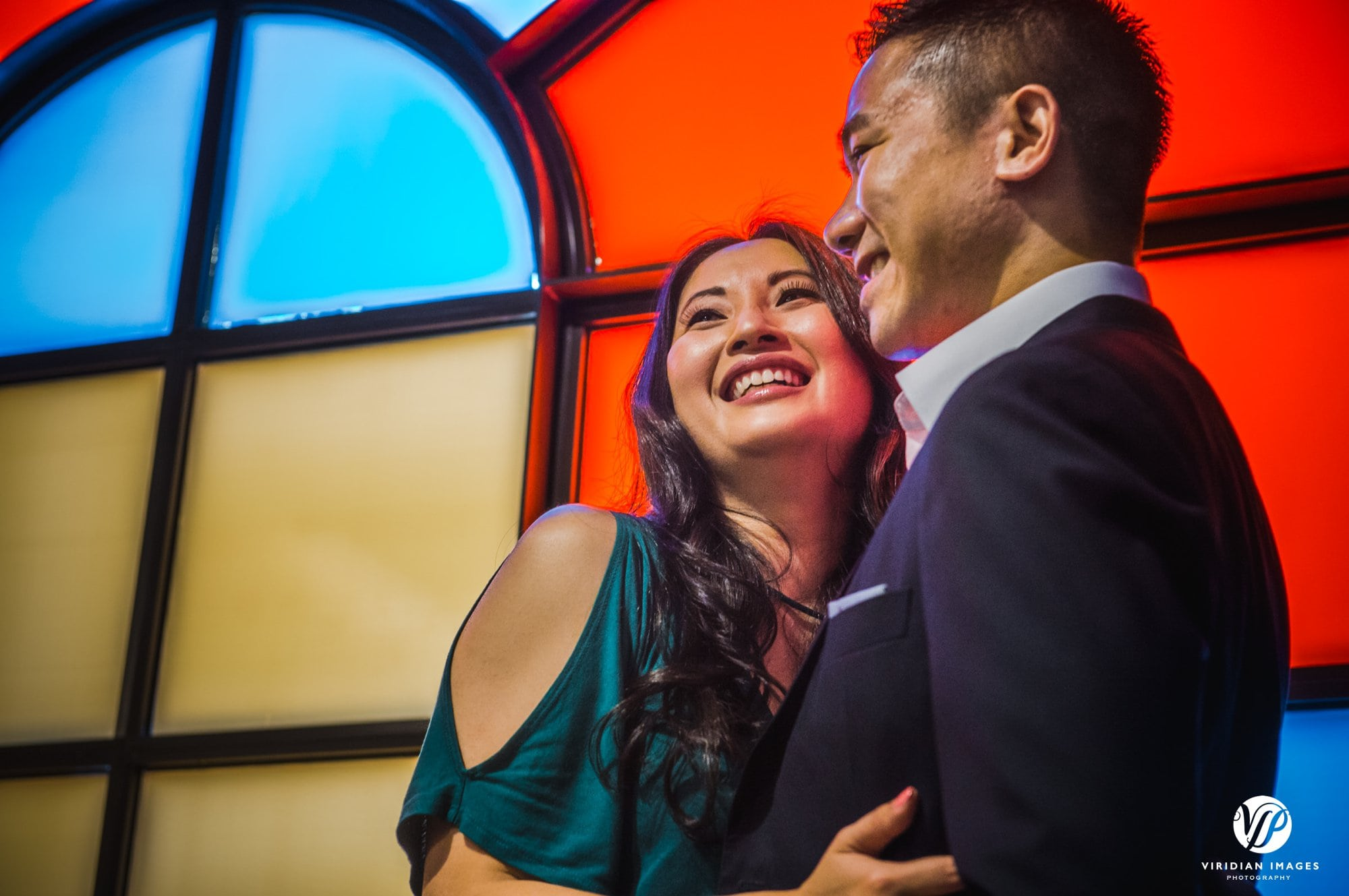 couple laughing stain glass window
