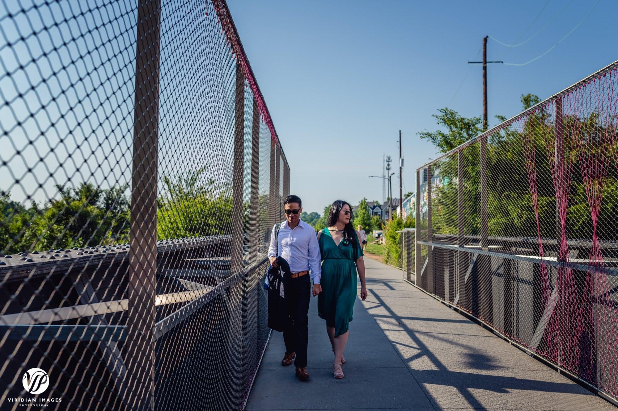 couple walking on beltline bridge sunglasses