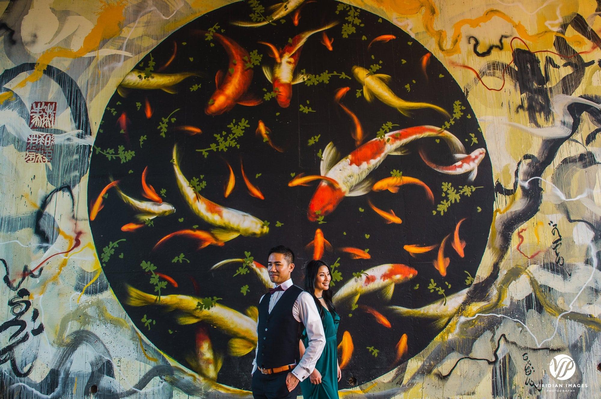 editorial portrait front of fish mural beltline
