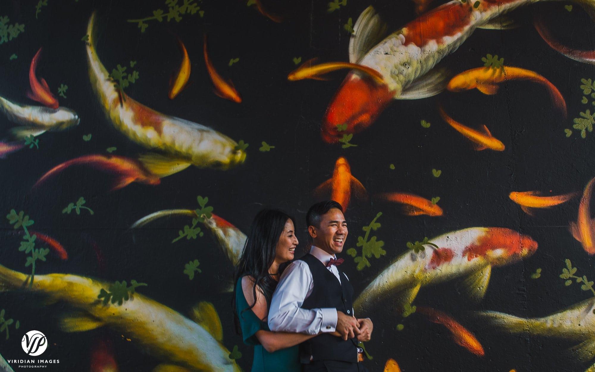 playful couple tickling fish mural atlanta beltline