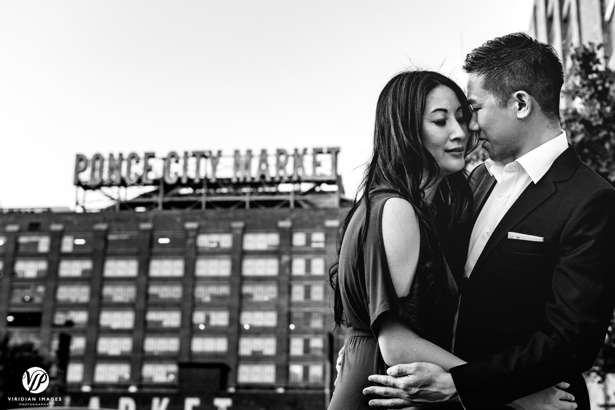romantic couple front of ponce city market sign
