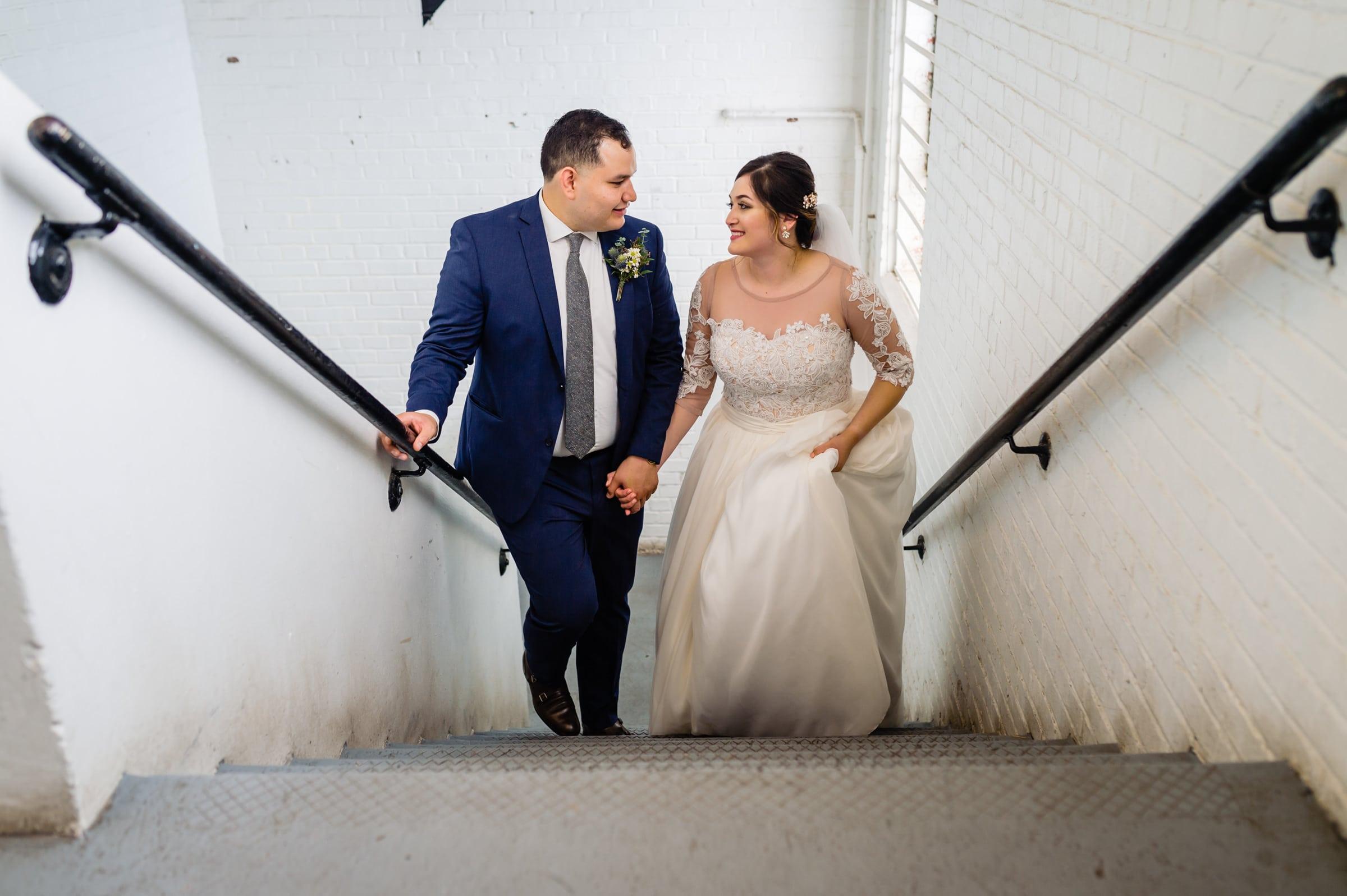 Bride Groom running up stairs
