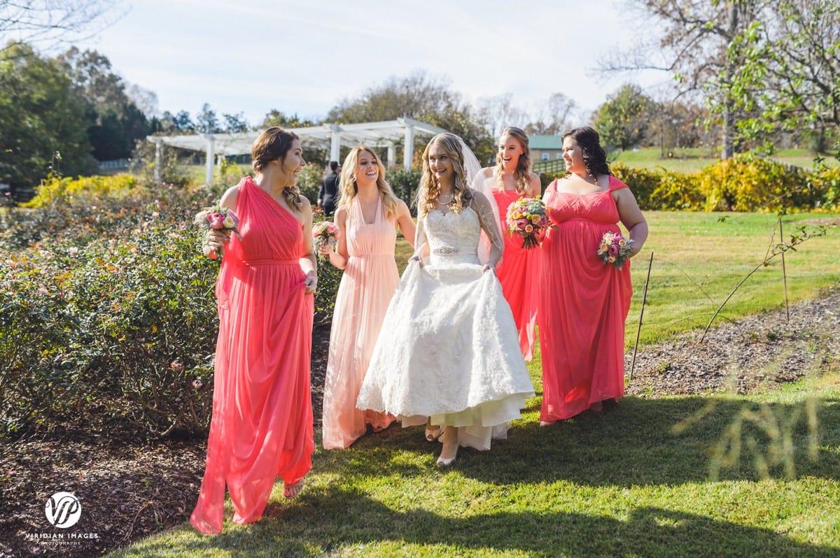 Bride with bridesmaids walking Walnut Hill Farm