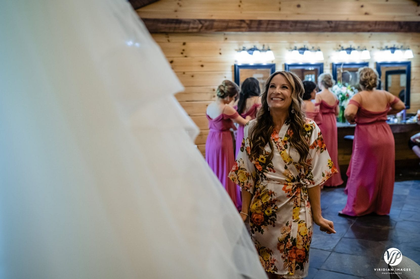 happy bride to be admiring dress hanging
