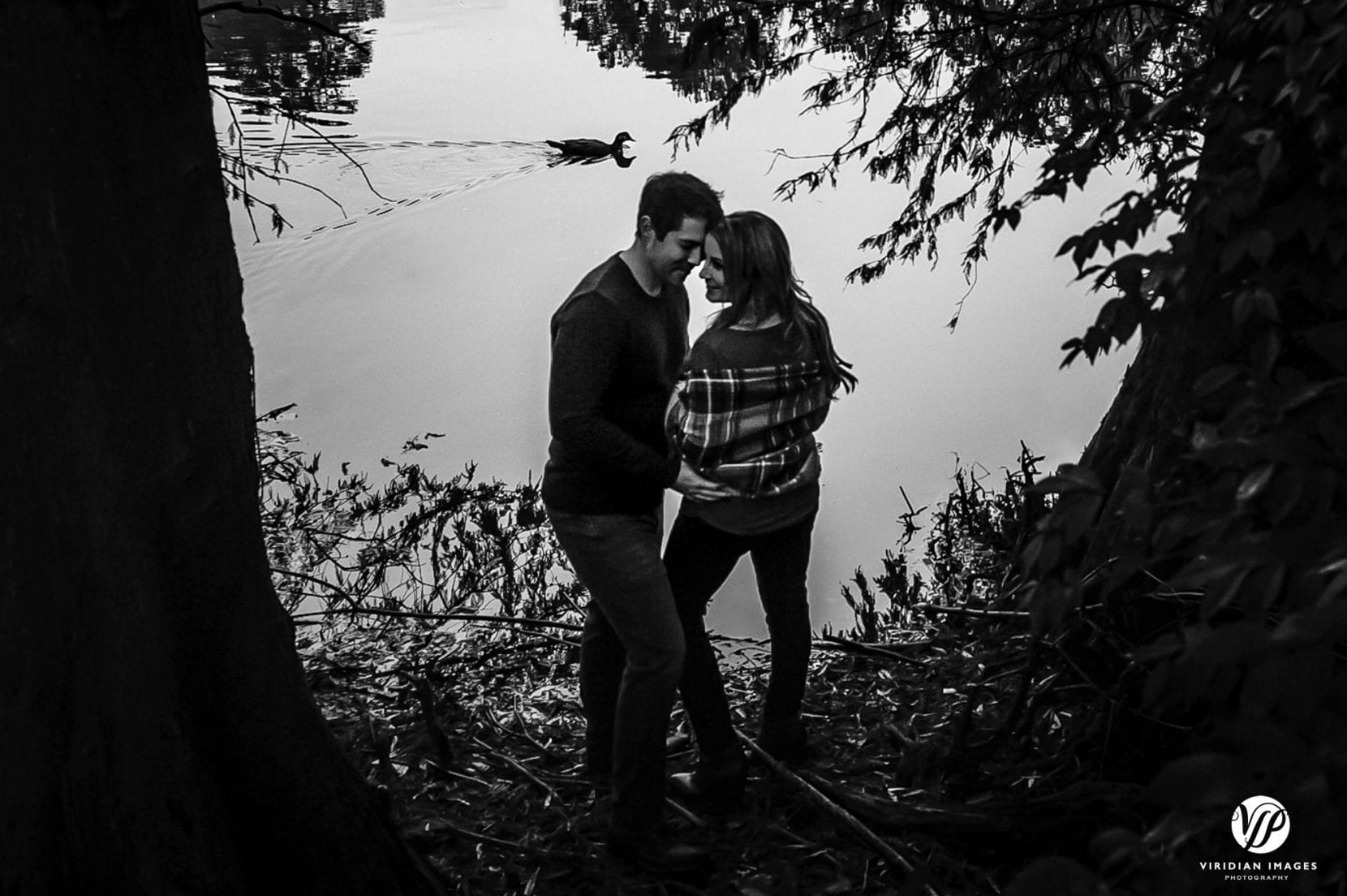 black and white engagement photo at piedmont park with duck