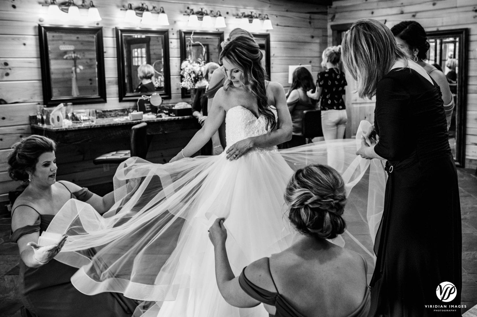 bridesmaids preparing dress for departure to ceremony