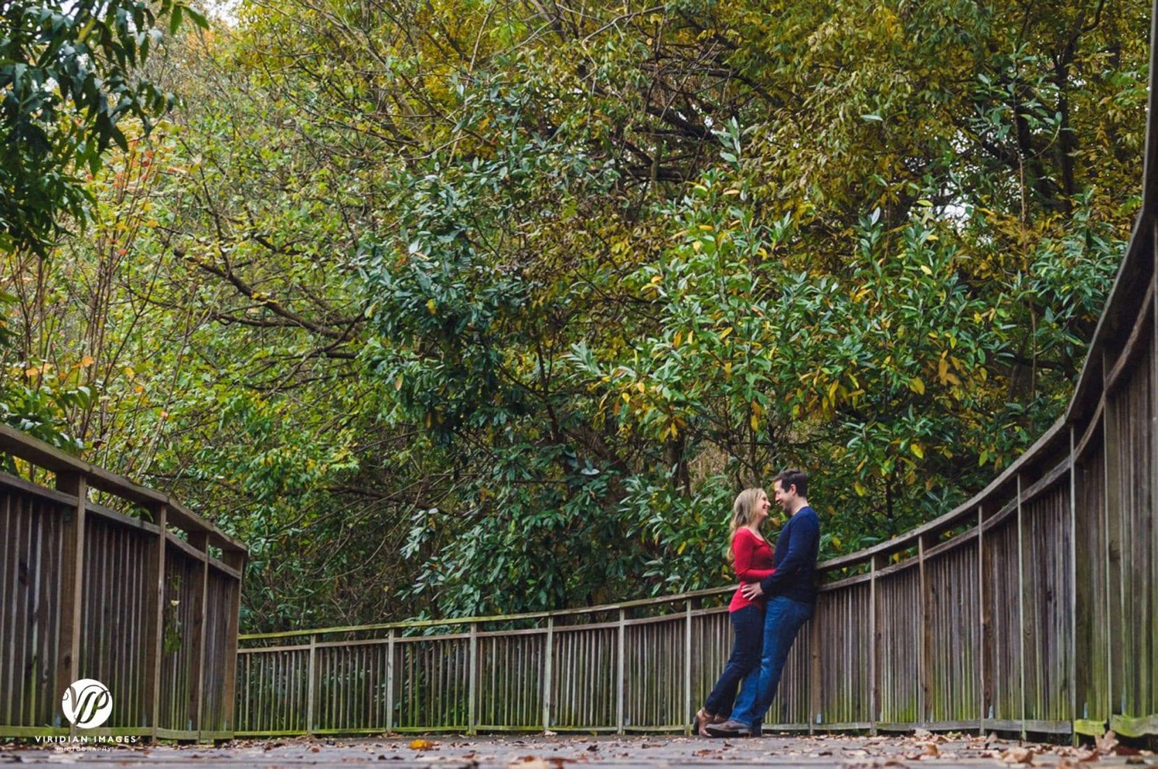 couple stop along boardwalk at piedmont park