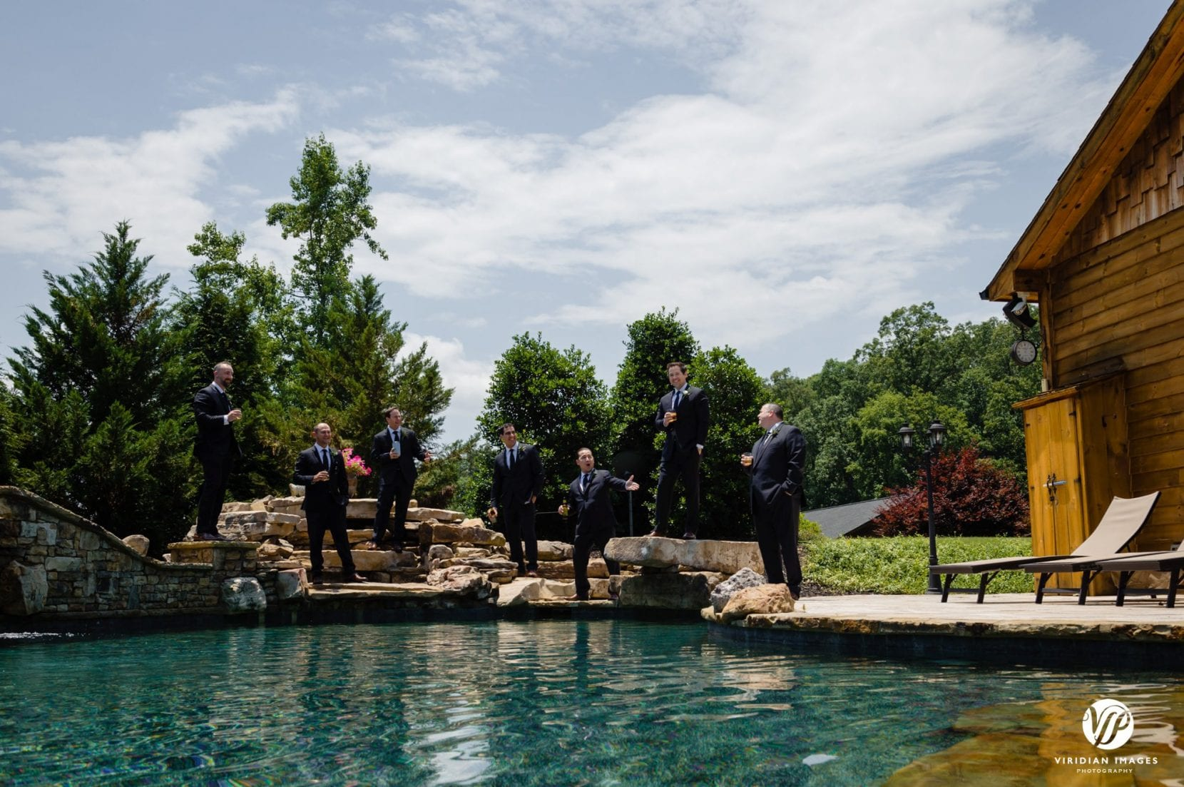groomsmen portrait at pool house