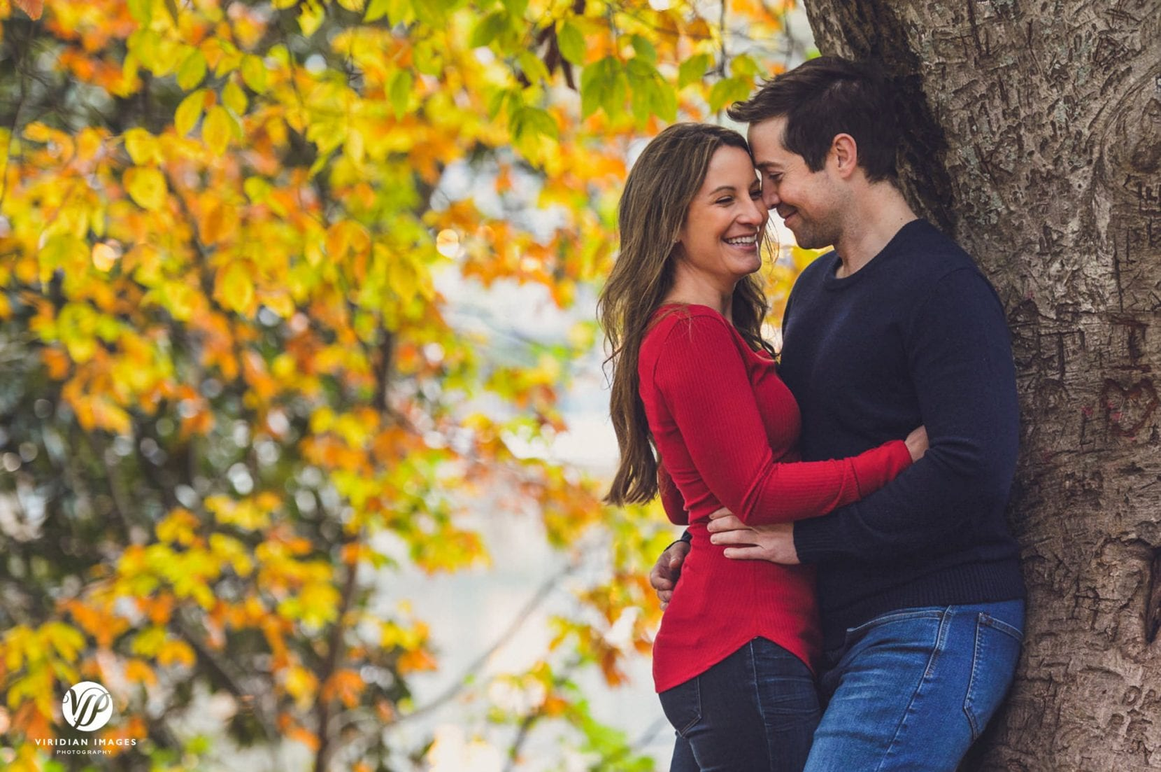 fall engagement photos at piedmont park couple embrace