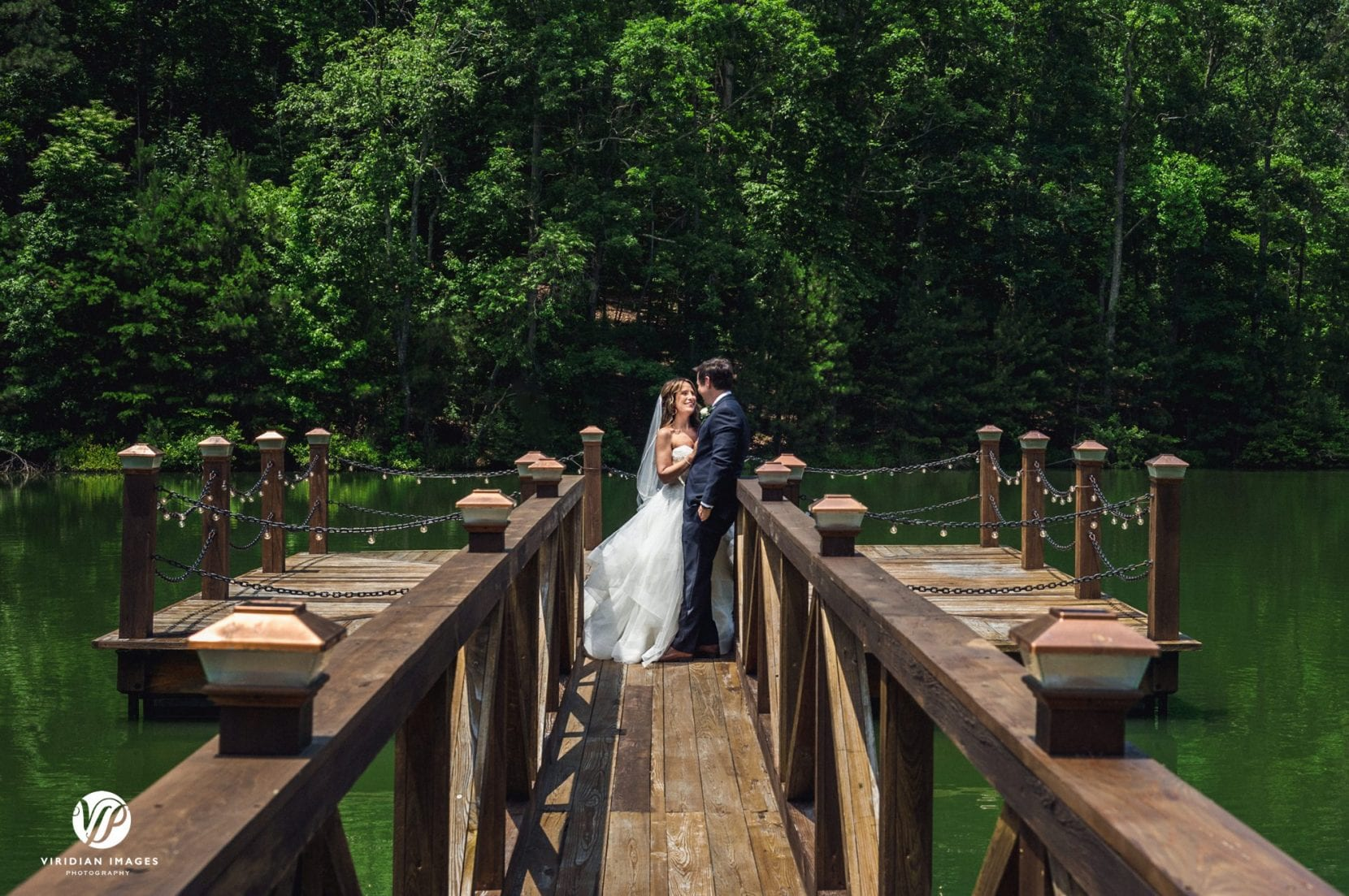 bride and groom portrait on dock