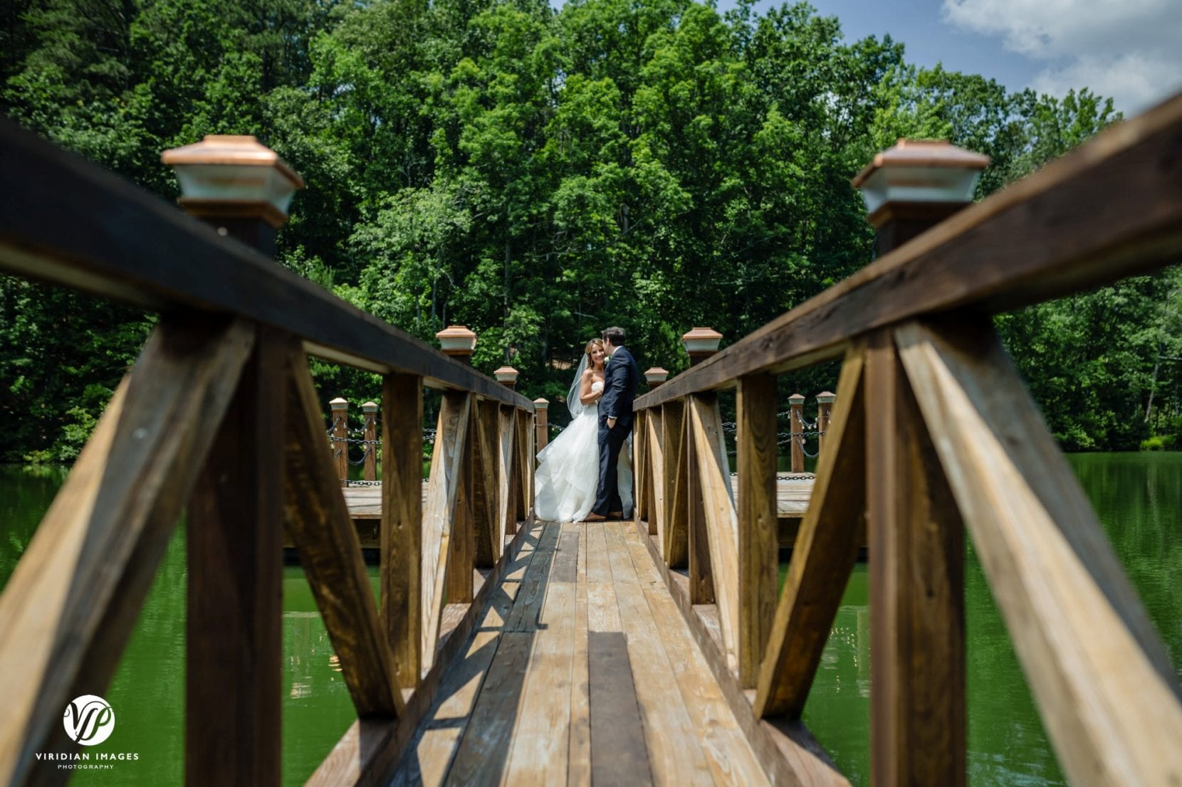 wedding couple portrait on dock lower angle