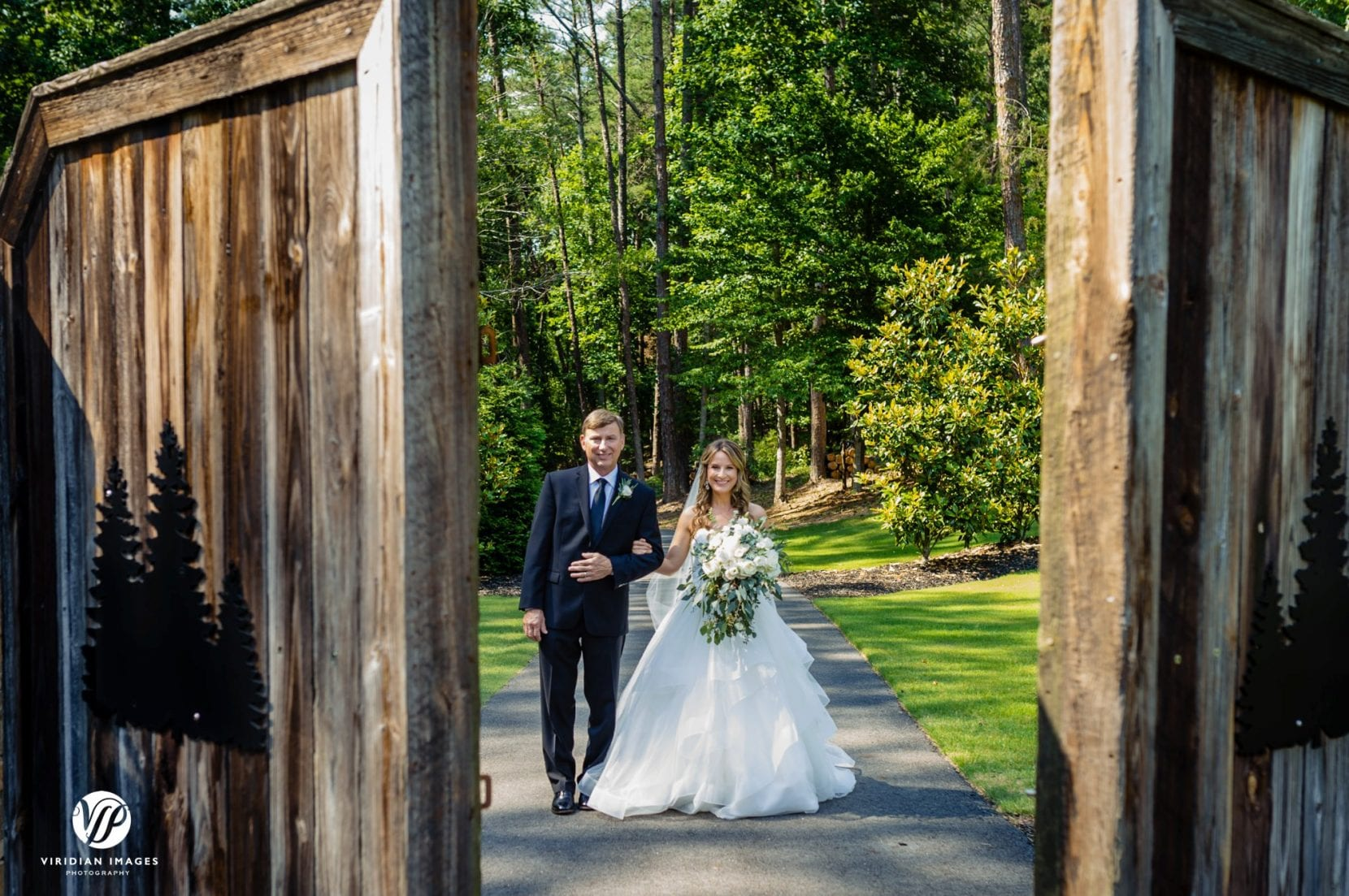 father and bride open barn doors