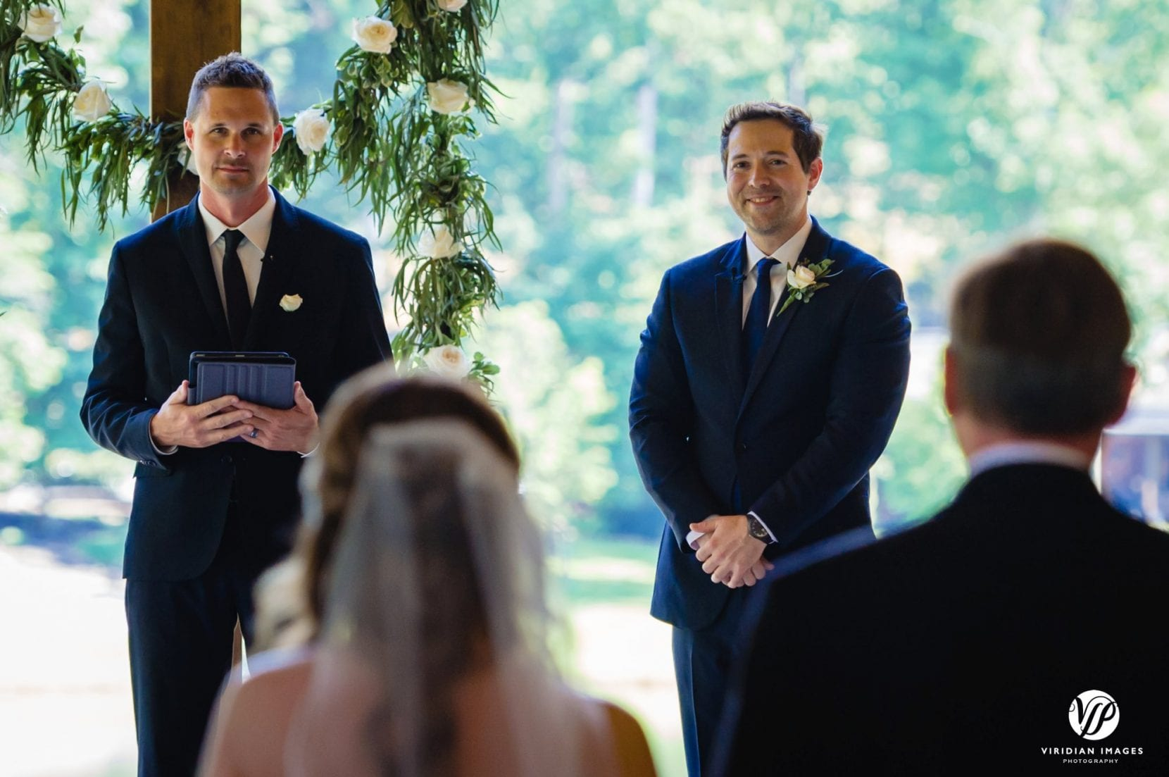 groom sees bride down aisle