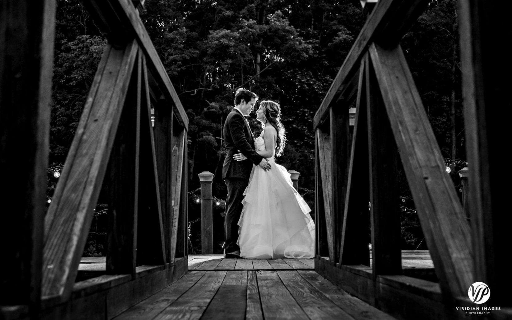 dusk photos with bride and groom on dock