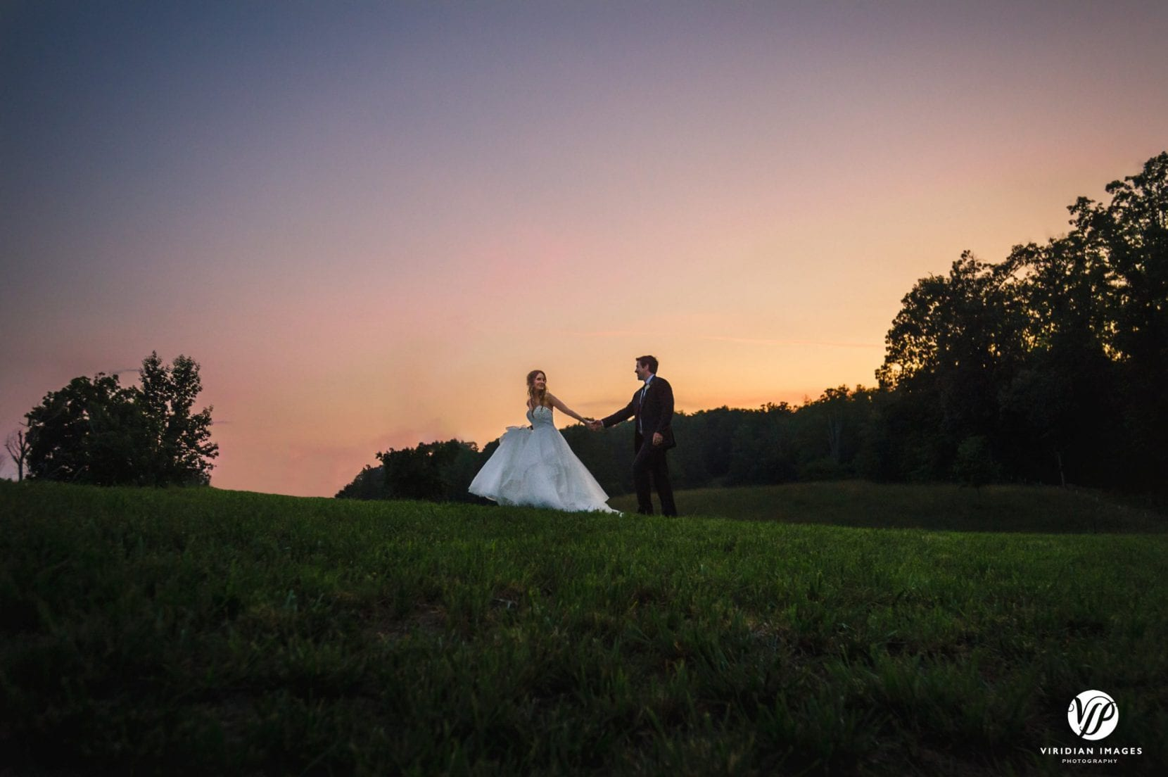 sunset portraits with bride and groom