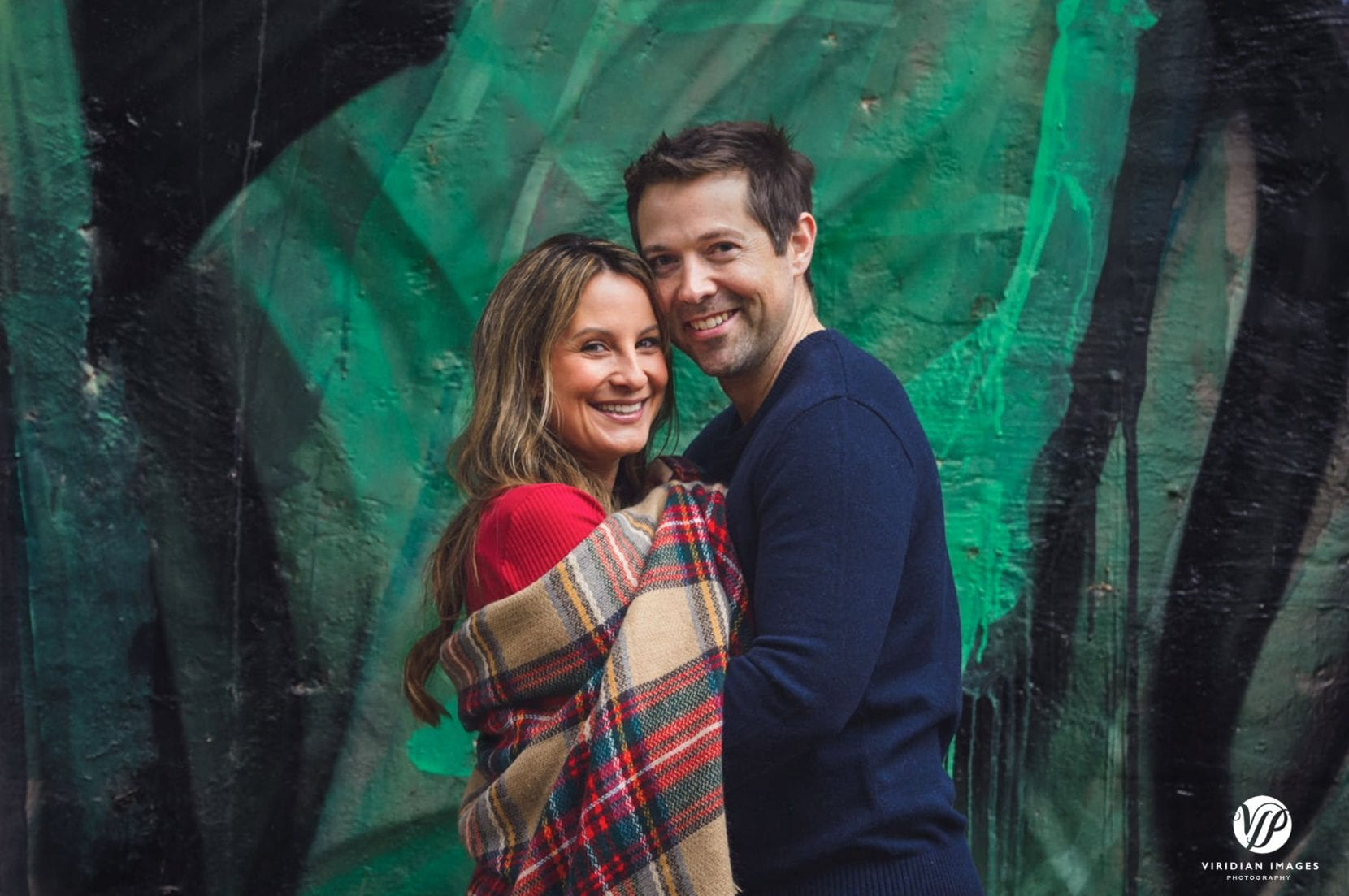 couple portrait in front of mural at Piedmont Park