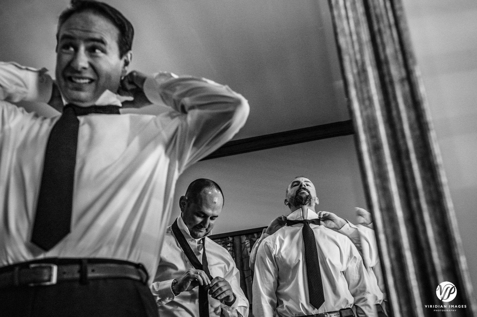 groomsmen tying ties