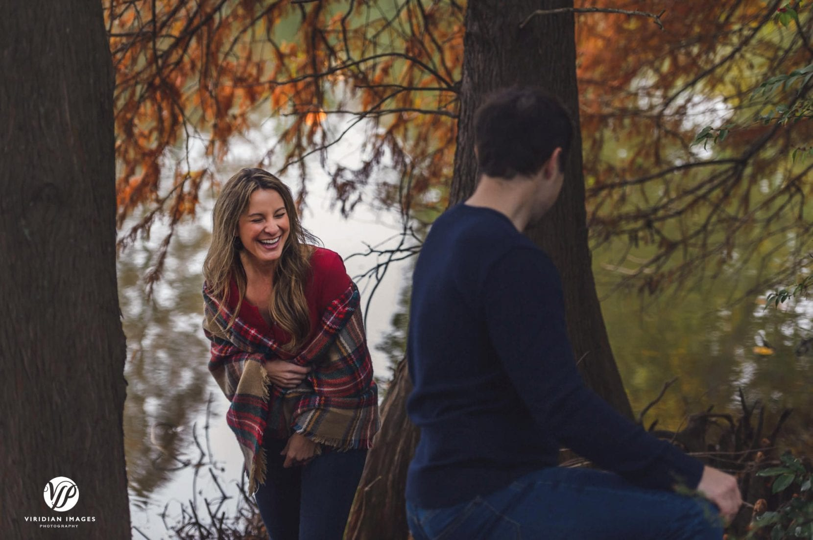 couple laughing during engagement photo session at piedmont park