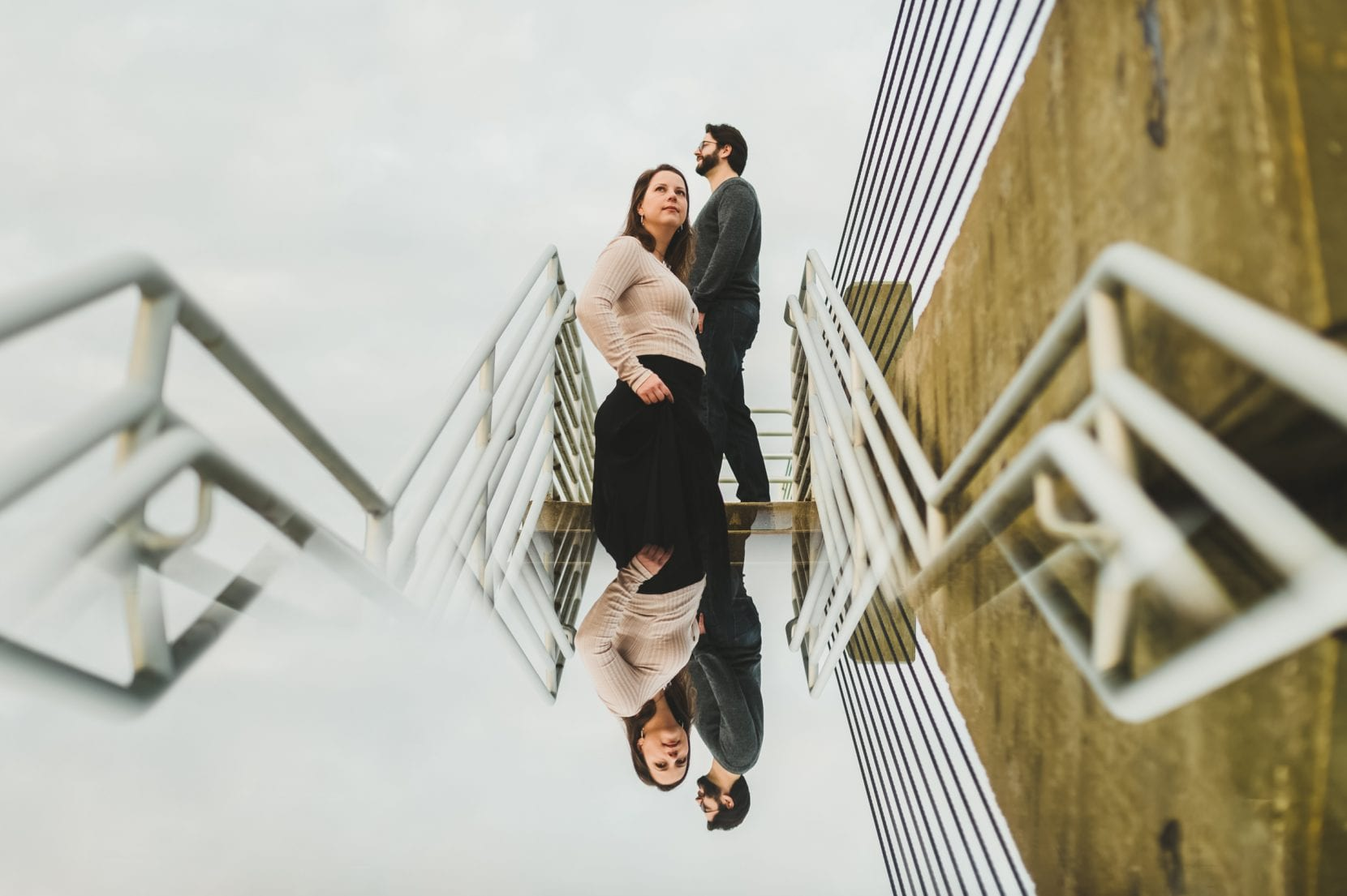 reflection shot of couple on stairs