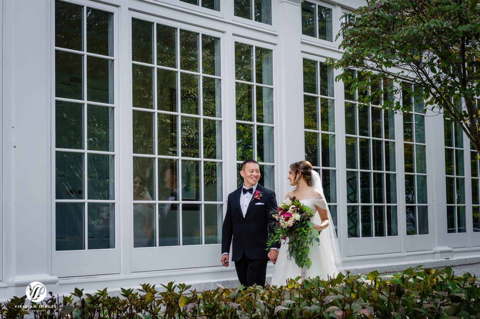 couple walking by windows