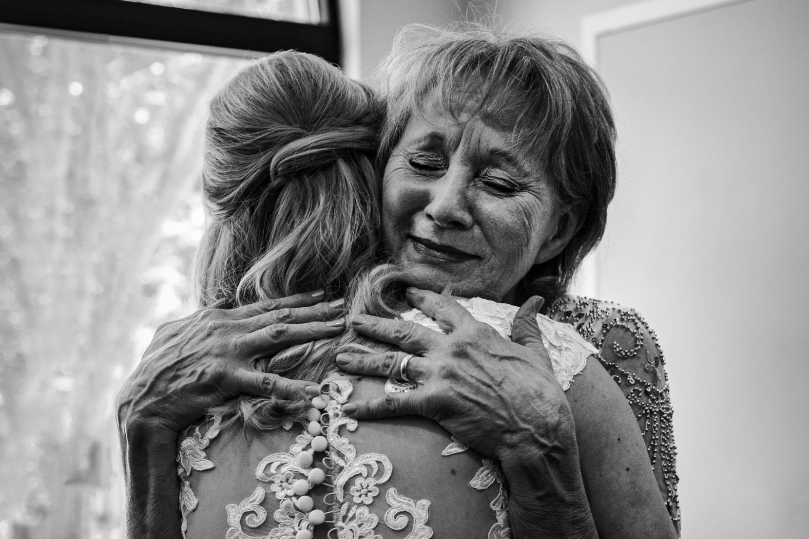 mother hugging during getting ready