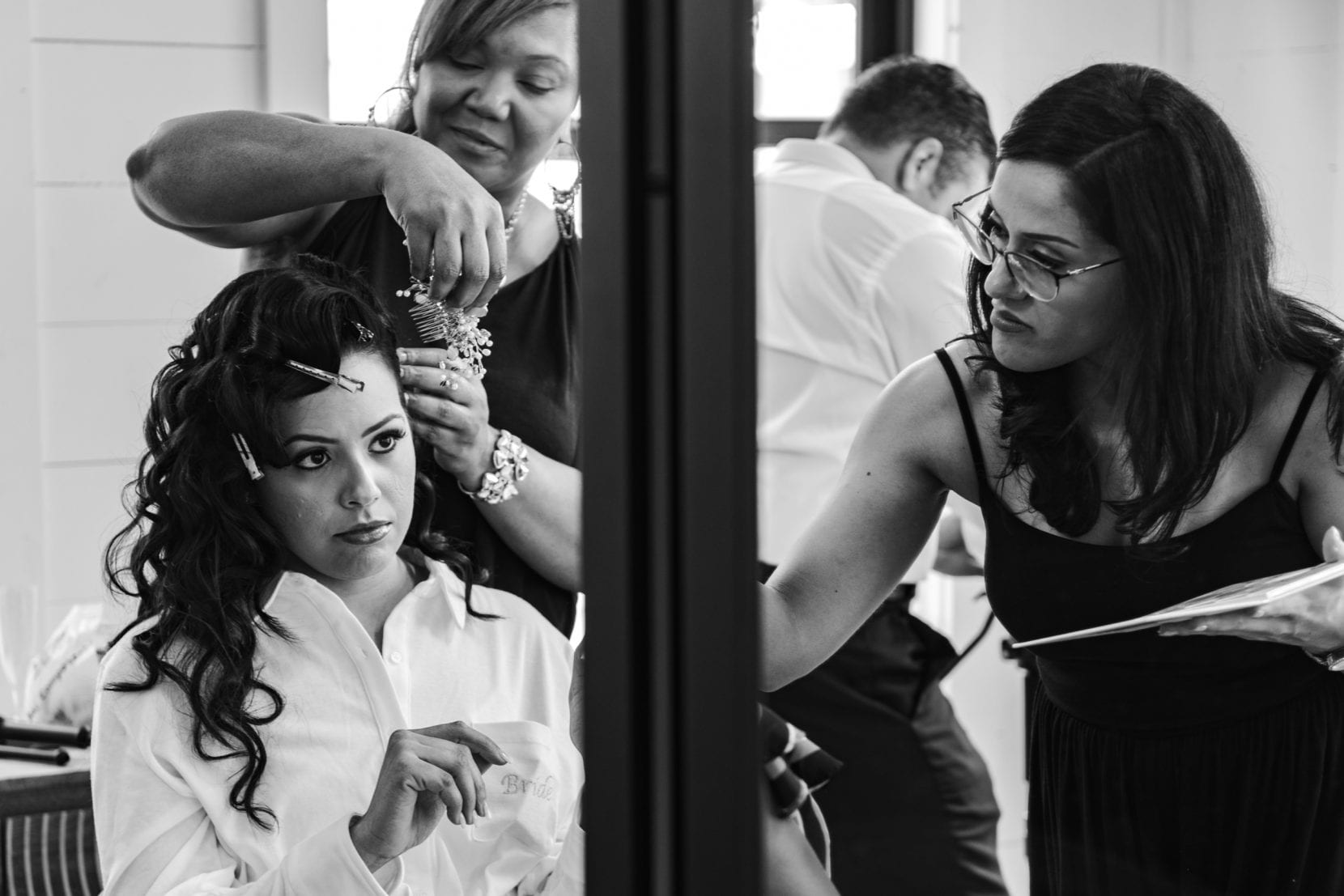 bride getting ready with team bw