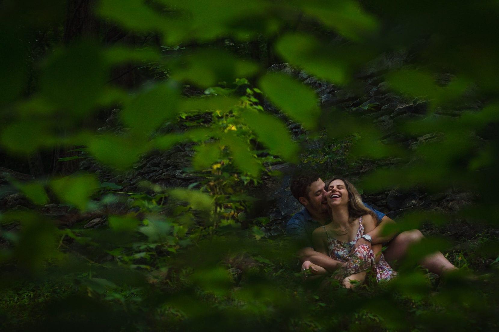 couple sitting along river sope creek