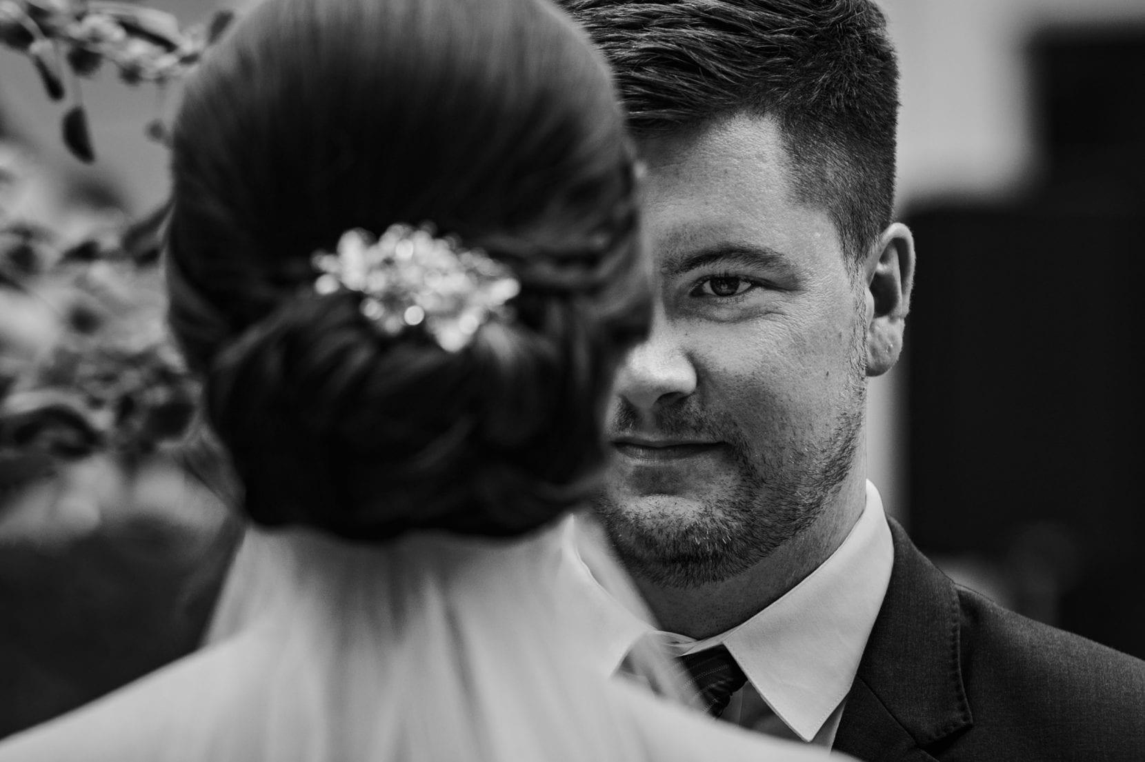 groom looks bride ceremony