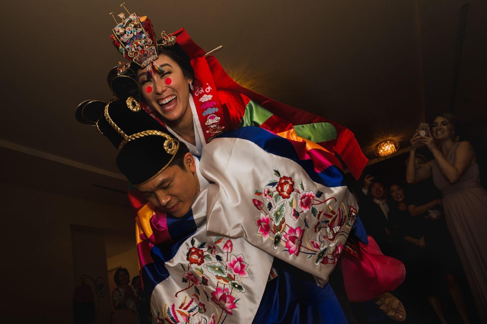 korean groom carries bride ceremony