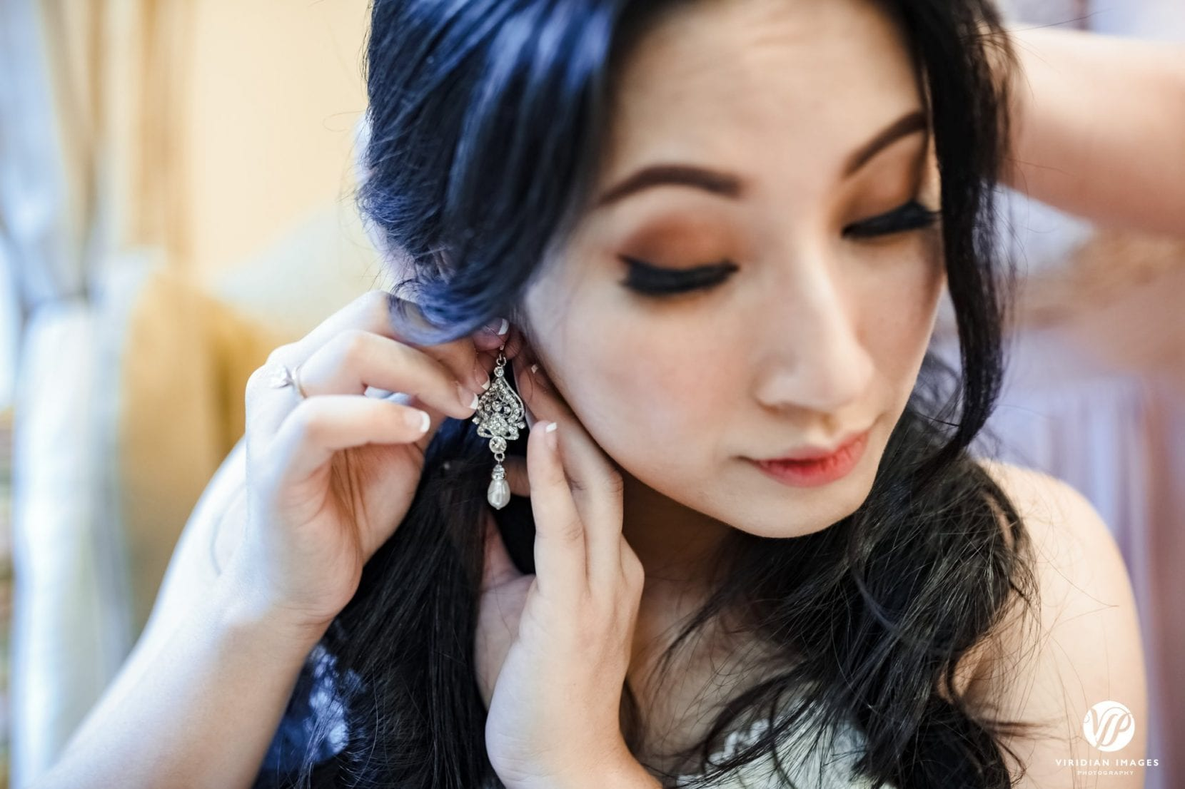 bride putting on earing