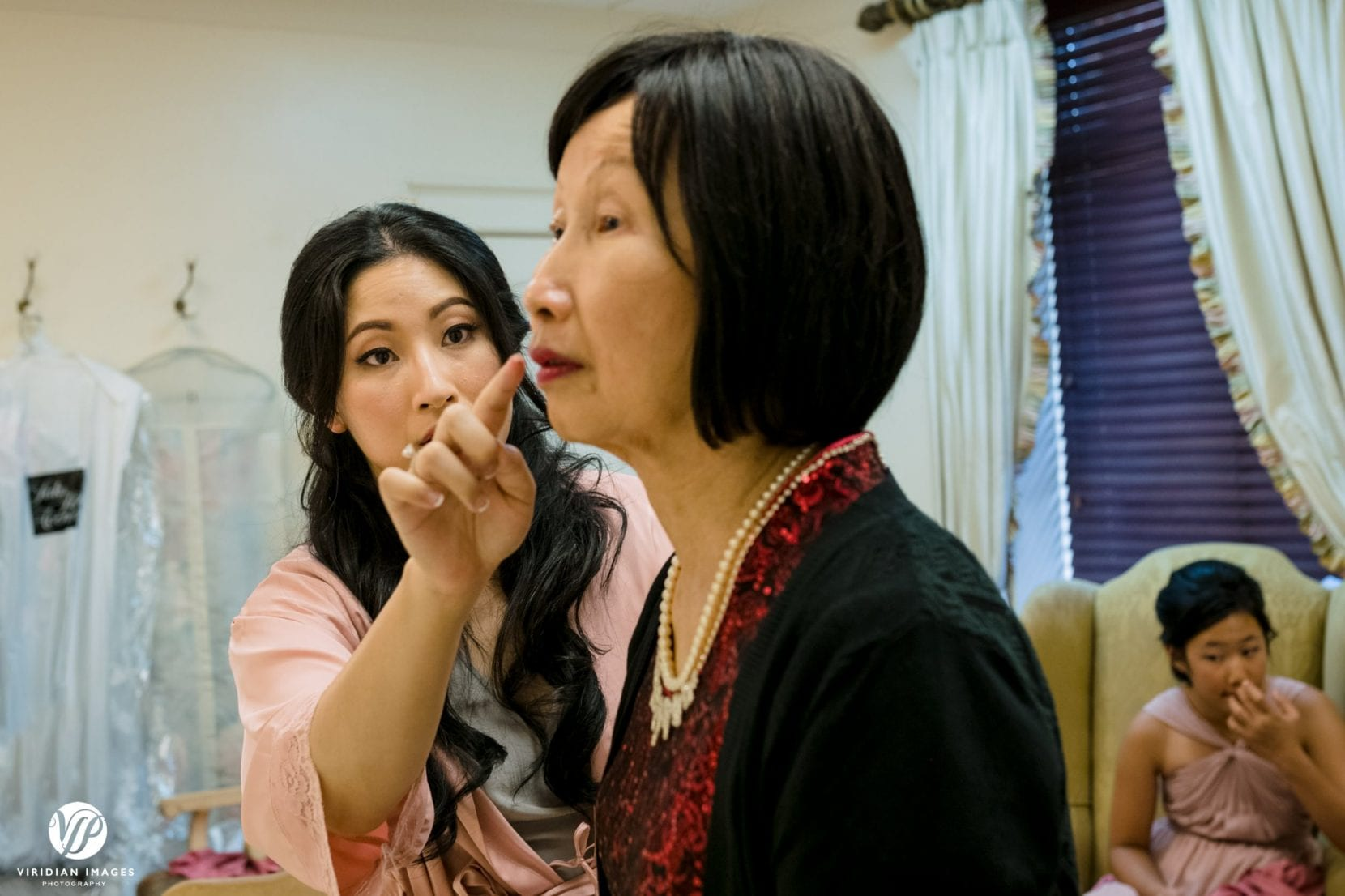 bride helping mother makeup