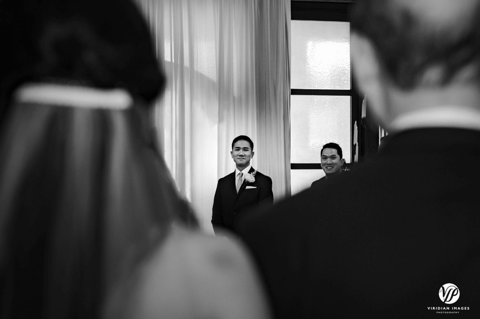 ceremony groom sees bride with father