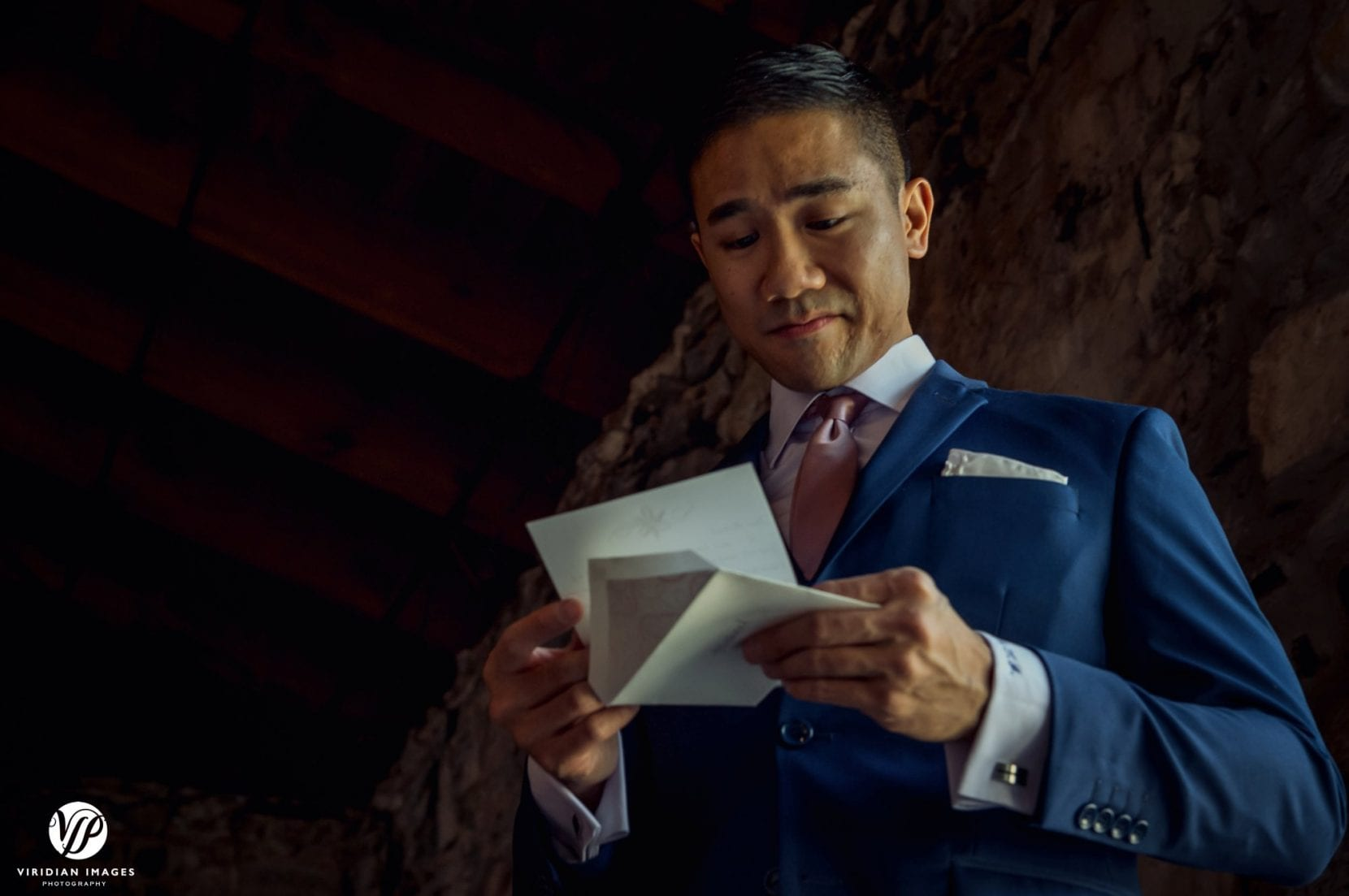 groom emotional reading bride letter
