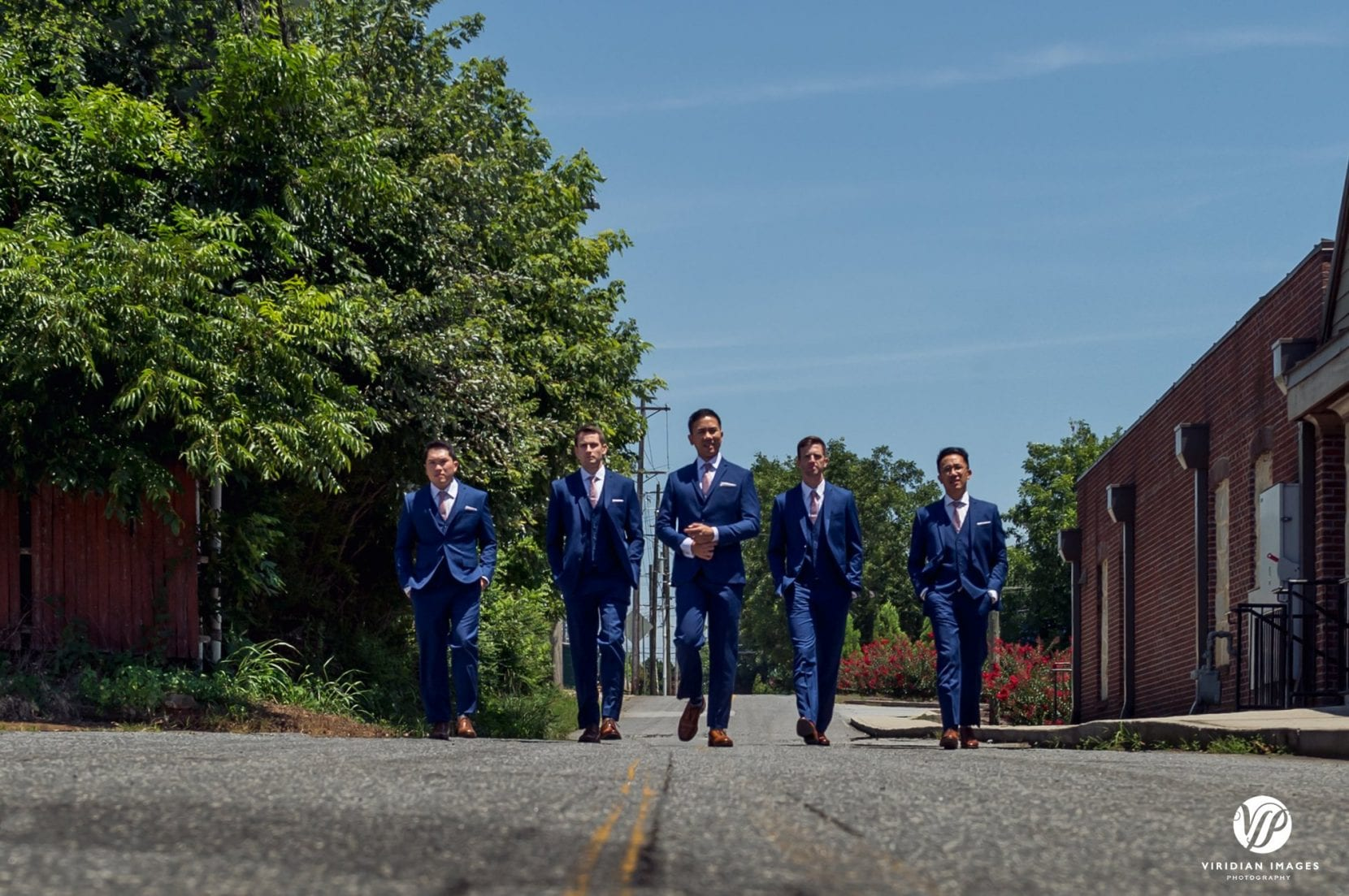 groom, groomsmen walking on street