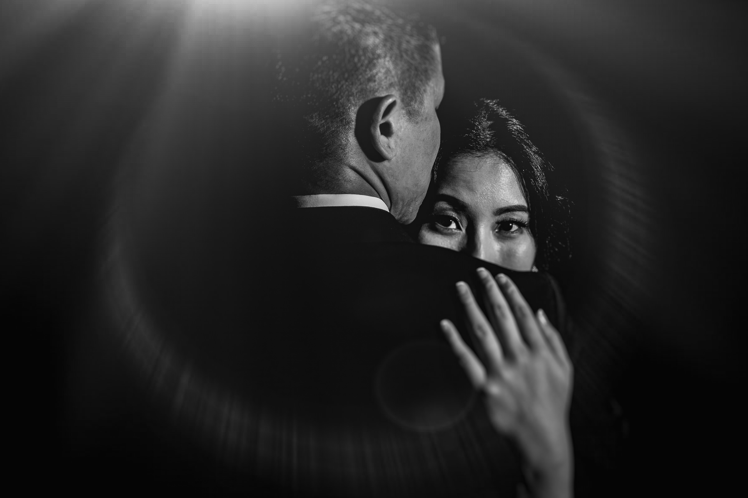 black and white wedding portrait with flare