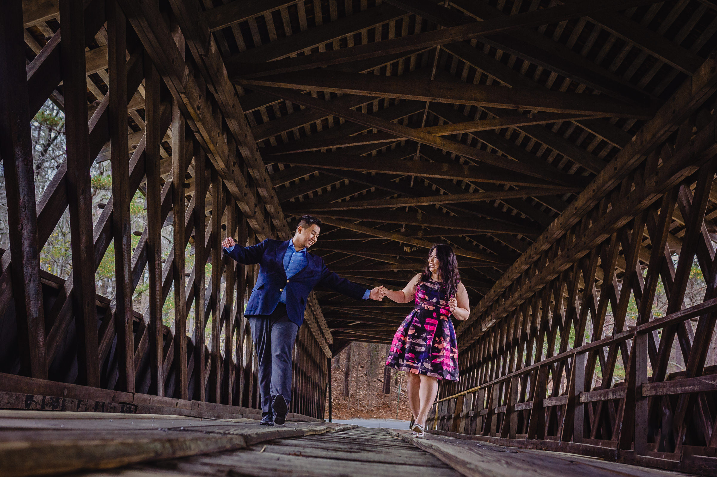 couple having fun covered bridge